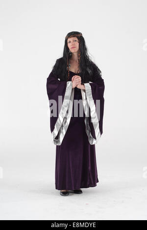 Woman in fancy dress comedy costume in a medieval queen historical outfit with black dress - Stock Photo