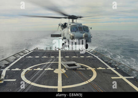 Atlantic Ocean, January 15, 2014 - An MH-60R Sea Hawk helicopter lands aboard the guided-missile frigate USS Halyburton - Stock Photo