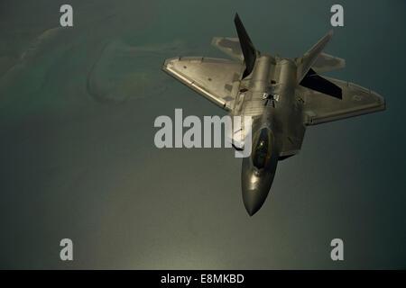 April 25, 2014 - A U.S. Air Force F-22 Raptor flies after being in-air refueled over the U.S. Central Command Area - Stock Photo