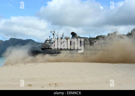 Marine Corps Training Area Bellows, Hawaii, July 27, 2014 - A landing craft air cushion (LCAC) departs for an equipment - Stock Photo