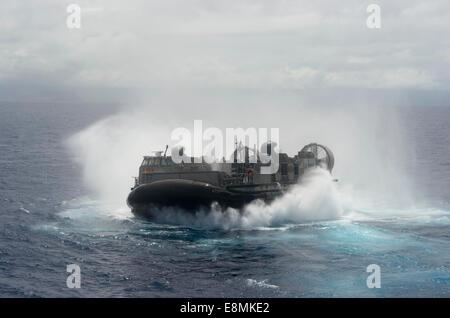 July 13, 2014 - A U.S. Navy landing craft air cushion departs from the amphibious dock landing ship USS Rushmore - Stock Photo