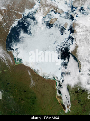June 18, 2014 - View of ice breaking up on Hudson Bay. Sea ice appears white, open water is dark blue. - Stock Photo