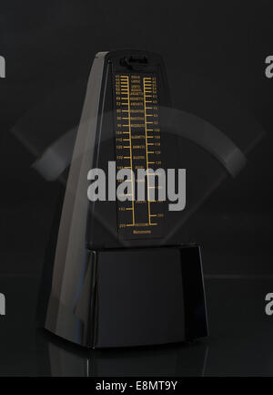Ticking metronome - Stock Photo