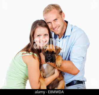 Portrait of a Happy Young Couple with a Dog. - Stock Photo