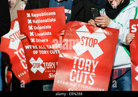 Belfast, Northern Ireland. 11/10/2014 - Banners calling for the end of Tory austerity cuts at a protest. - Stock Photo