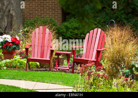 ... Two Red Lawn Chairs And Small Red Table Sitting On A Lawn On A Bright  Sunny