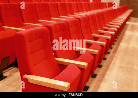 Red and empty theater seats - Stock Photo