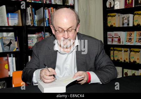 Salman  Rushdie, novelist,  Man Booker Prize winner and writer of Midnight's Children and The Satanic Verses signs - Stock Photo