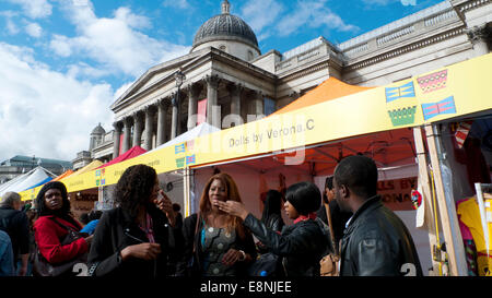 Trafalgar Square, London UK. 11th October 2014. Crowds walk along the market stalls at 'Africa on the Square' Festival - Stock Photo
