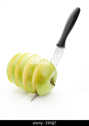 sharp knife, cut into pieces green apple on a white background - Stock Photo