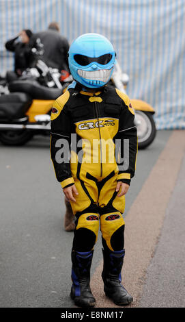 Brighton, Sussex, UK. 12th October, 2014. A young biker joins thousands of bikers arrive on Brighton's seafront - Stock Photo