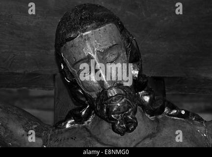Spain, St. James Way: Face of crucified Christ in the romanesque church Santa Maria in O Cebreiro in black and white - Stock Photo