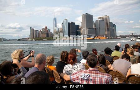Tourists sightseeing boat ride New York skyline - Stock Photo