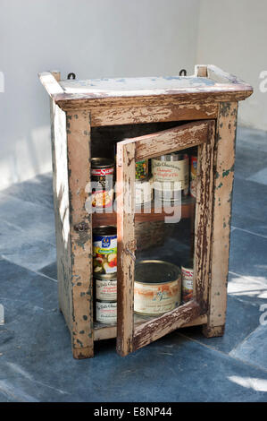 Picture by Roger Bamber : 30 June 2014 : An old battered Indian Tin food cabinet full with Ten tins of French food - Stock Photo