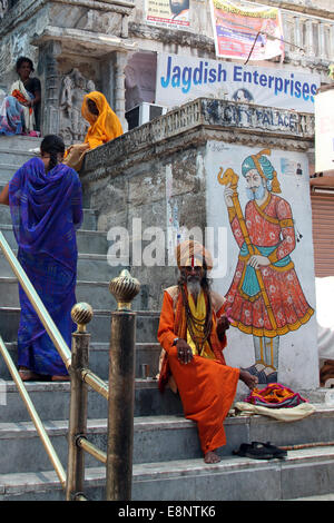Holy man outside the Jagdish Mandir temple in Udaipur, India - Stock Photo