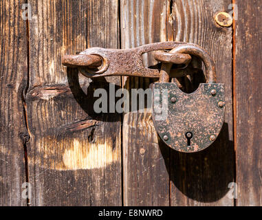 Rusty padlock on an old wooden door - Stock Photo