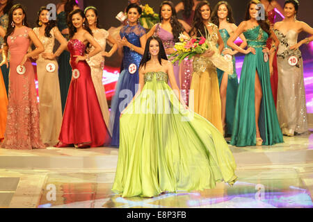 Pasay City, Phillipines. 13th October, 2014. Valerie Weigmann presents her evening gown at the Miss World Philippines - Stock Photo