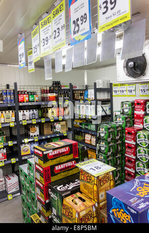 Different brands of beer in the walk in cold section in a New Zealand supermarket with discount signs. - Stock Photo