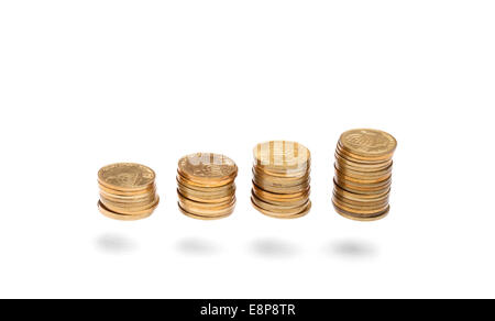Columns of coins with ascending height isolated with shadow on white - Stock Photo