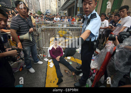 Hong Kong, CHINA. 3rd Oct, 2014. An activist in the pro-democracy movement is injured and attended to by medics - Stock Photo