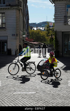 people cycling, nantes, france - Stock Photo
