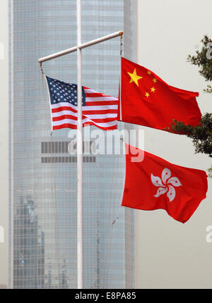 Hong Kong, CHINA. 3rd Oct, 2014. The flags of China, America and Hong Kong fly in downtown Hong Kong, near where - Stock Photo