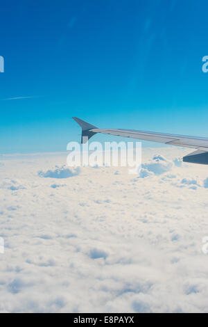 Wing of an airplane, view from window. - Stock Photo