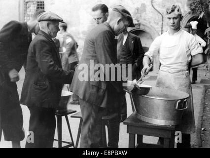 The picture from Nazi news reports shows Sudeten German refugees being fed in Augustusburg, Germany, September 1938. - Stock Photo