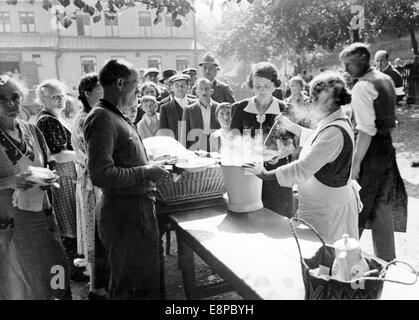 The picture from Nazi news reports shows Sudeten German refugees who fled from Czechoslovakia being fed by the National - Stock Photo