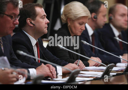 Moscow, Russia. 13th Oct, 2014. Russia's prime minister Dmitry Medvedev (2nd l) and his deputy Olga Golodets (R) - Stock Photo