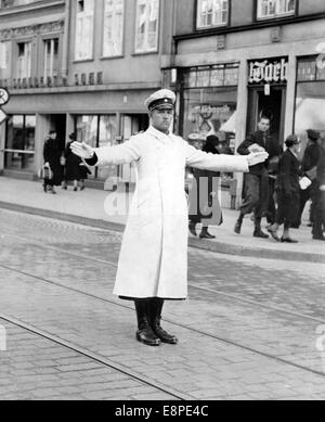 The Nazi propaganda picture shows a traffic policemans in the Nazi-governed Free City of Danzig, in May 1939. Photo: - Stock Photo