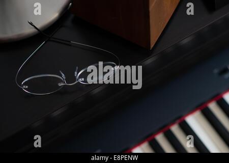 Glasses on Piano - Stock Photo