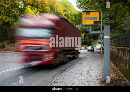 Blurred Moving traffic; Road vehicles speeding passing Gatso Meter, Traffic Speed Camera, City centre Penwortham, - Stock Photo
