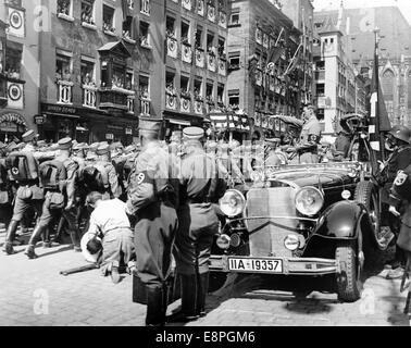 Nuremberg Rally 1935 in Nuremberg, Germany - SA (Sturmabteilung) troops march past Adolf Hitler during a parade - Stock Photo