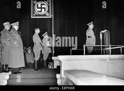 Nuremberg Rally 1937 in Nuremberg, Germany - Adolf Hitler holds a speech in an atmosphere created by searchlights - Stock Photo