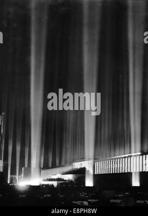 Nuremberg Rally 1936 in Nuremberg, Germany - Hundreds of searchlights flare up and illuminate the night sky after - Stock Photo