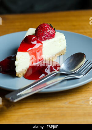 Fresh Strawberry Cheesecake with spoon and fork on dish - Stock Photo