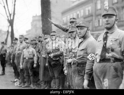 Nuremberg Rally in Nuremberg, Germany - Men of the Sturmabteilung (SA) stand on the side of the road during a rally. - Stock Photo