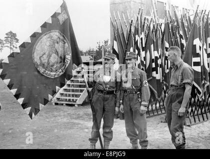 Nuremberg Rally 1938 in Nuremberg, Germany - Members of the Sturmabteilung (SA) present the first Austrian SA flag - Stock Photo