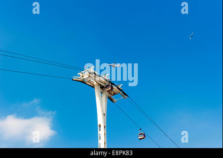 London Emirates Cable Car which crosses the River Thames with 3 planes also in view. - Stock Photo