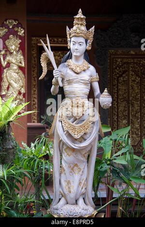 Female statue Peliaton Palace Ubud Bali Indonesia - Stock Photo