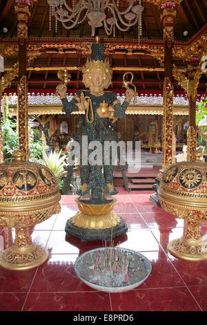 Temple statue Peliaton Palace Ubud Bali Indonesia - Stock Photo