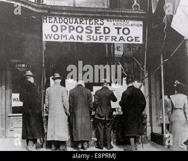 Passers-By Looking at Window Display at the Headquarters of National Association Opposed to Woman Suffrage, ca. - Stock Photo