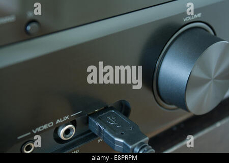 USB Cable connected in a black AV-Receiver - on black table - Stock Photo