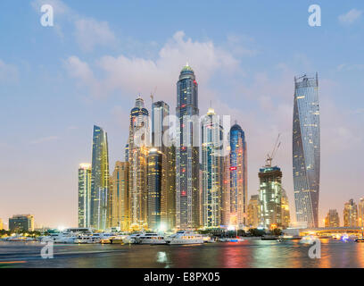 Skyline at dusk of skyscrapers in Marina district in Dubai United Arab Emirates - Stock Photo