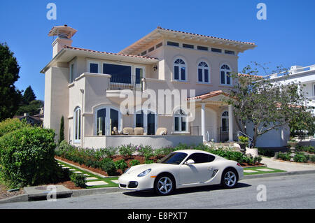 luxury sports car parked in front of luxury Bay front home in Mill Valley California - Stock Photo