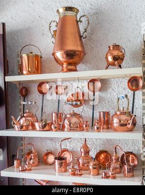 Portuguese copper utensils displayed in souvenir shop - Stock Photo