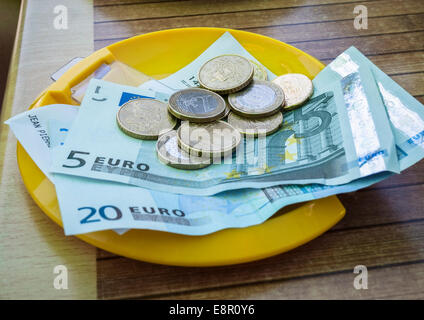 Payment in restaurant with French euros - Stock Photo