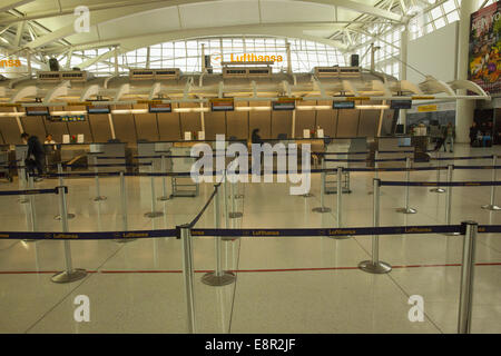 Empty Lufthansa check-in ticket counter area at JFK Airport in New York City. - Stock Photo