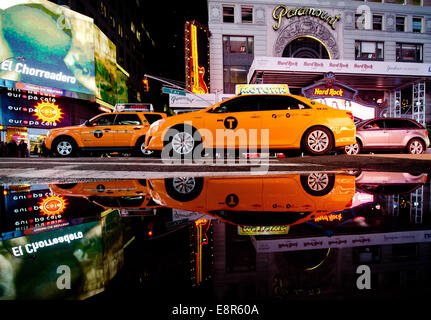 New York, USA. 26th Sep, 2014. Taxis drive across Times Square in New York, USA, 26 September 2014. Photo: Daniel - Stock Photo